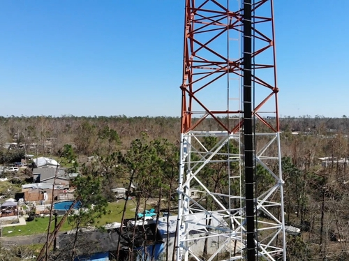 Cell tower surrounded by damage (option)