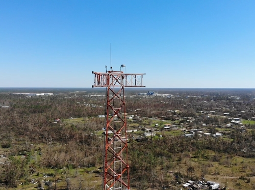 Cell tower surrounded by damage