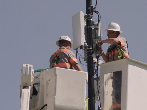 Technicians installing 5G node