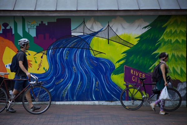 Bicyclists with Street Art