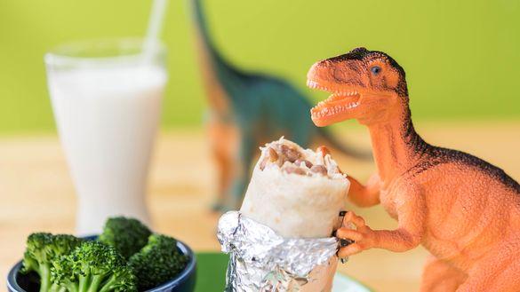 Toy Dinosaur Eating at Laughing Planet