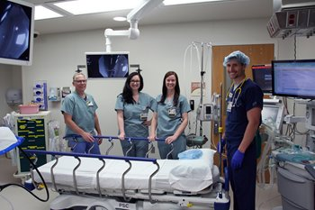 Providers stand in the new pediatric endoscopy suite