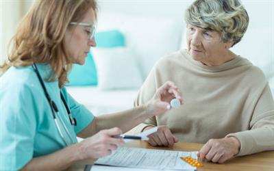 Physician discussing medications with a female patient