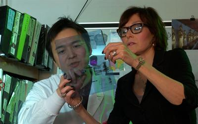 Scientists Lynne E. Maquat, Ph.D. with a trainee in her lab