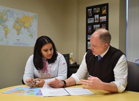 Passport Health clinical director Matthew Klapetzky meets with a client.