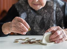 elderly person counting coins