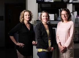 three female scientists standing in a lab