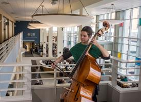 Eastman Performing Arts Medicine program manager Gaelen McCormick playing double bass at Strong Memo