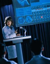 Female doctor presenting data at meeting