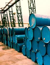stacks of blue metal barrels of chemicals