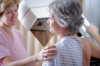Mammography tech with patient