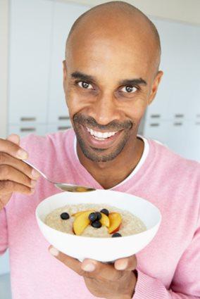 man eating oatmeal