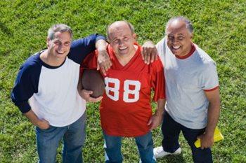 three mature men smiling