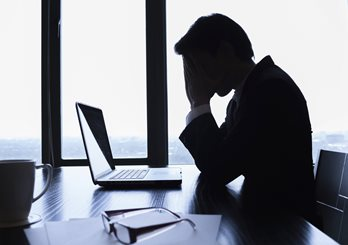 worried man sitting at a desk