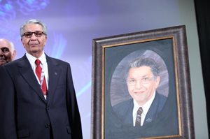 Dr. Bahreman with painting of him