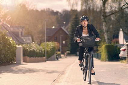 Woman riding a bicycle to her workplace