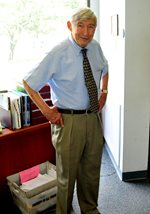 Dr. Subtelny standing in his offic e