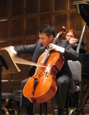 James Kim playing a cello