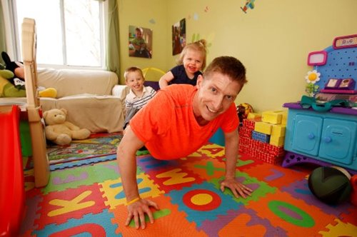 Joe Mercik doing pushups with his kids
