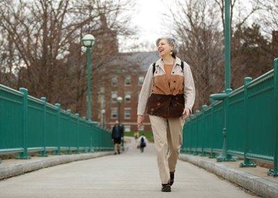Harriette Royer walking across bridge