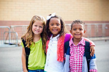 three school-aged children