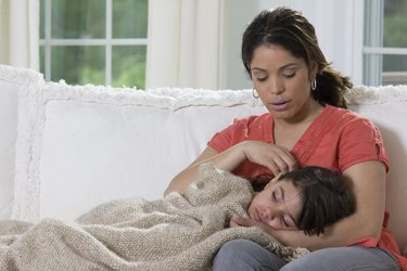 mother comforting a sick child
