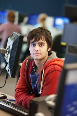 young, male college student at computer
