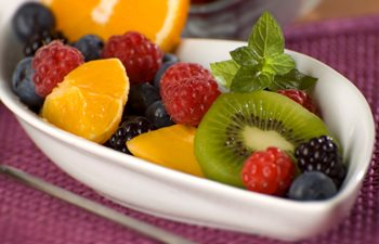 bowl of berries, oranges and kiwi fruit