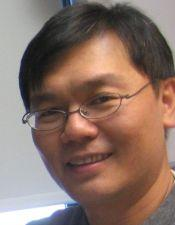 Headshot of Dr. Wei Hsu smiling and wearing glasses.