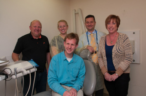 Greg with family and dentists