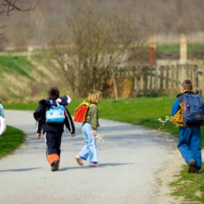 Two boys and two girls going to school