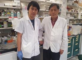 environmental portrait of two Asian males in a science lab
