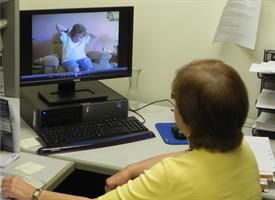 health care provider evaluating person with dementia using telemedicine