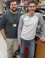 two scientists standing in Scott Gerber's laboratory for pancreatic cancer research