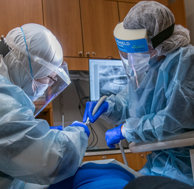 Dental Assistant with Dentist treating a patient