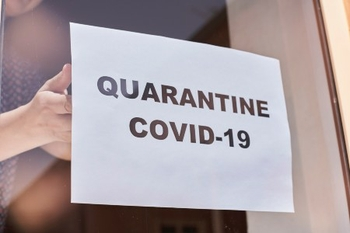 nursing home COVID quarantine sign on door