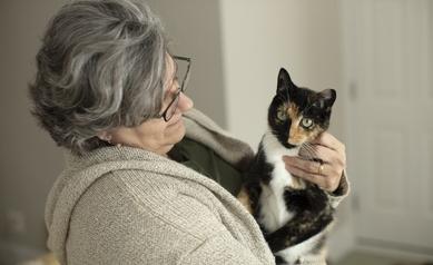 Paula Vertino holds her cat, Abigail.