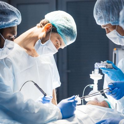 Diverse Team of surgeon, assistants and nurses making invasive surgery