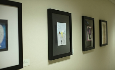 Artwork by patients and community members lines the department's Bridge Art Gallery walls.