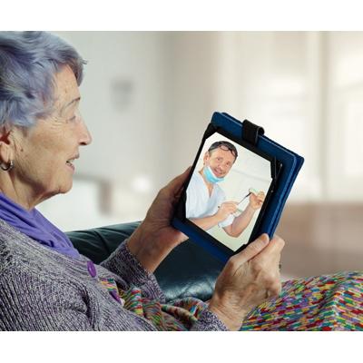 Senior-looking-at-tablet-we