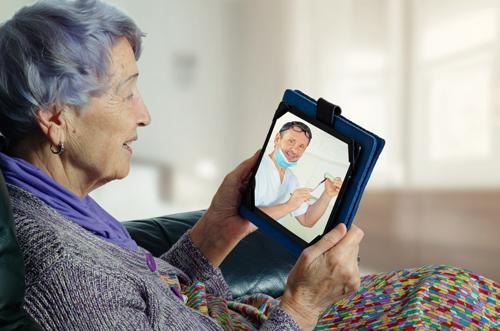 Nursing home resident engaging in teledentistry
