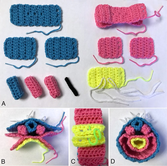 Multiple colored crochet pieces laying on white surface.