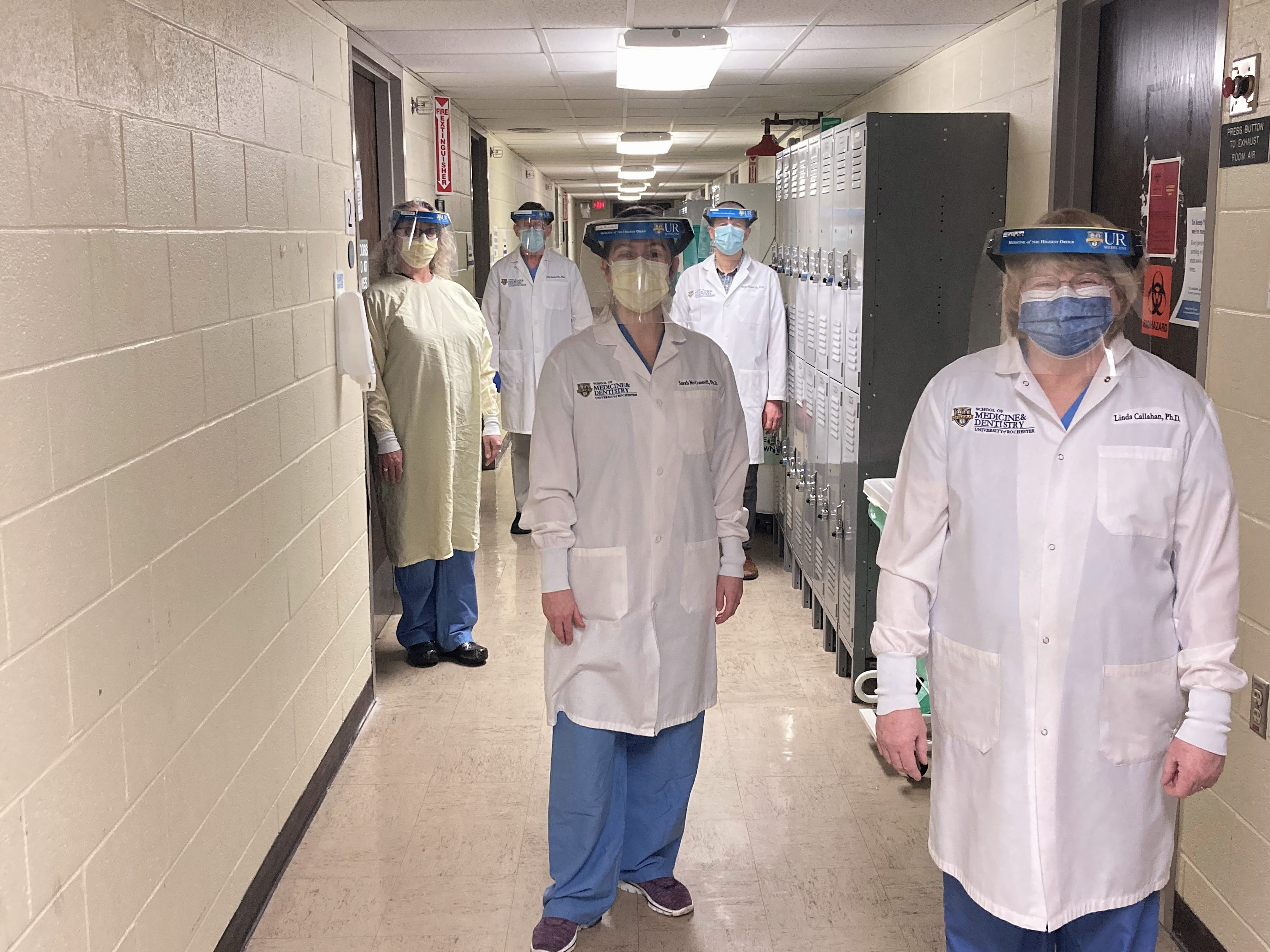 From Left: Jennifer Prutsman-Pfeiffer, Ph.D. (wearing the gown that students were required to wear in the anatomy laboratory), John Olschowka, Ph.D., Sarah McConnell, Ph.D., Sergiy Nadtochiy, Ph.D., Linda Callahan, Ph.D.   Not pictured: David Kornack, Ph.D., Diane Piekut, Ph.D., Martha Gdowski, Ph.D.