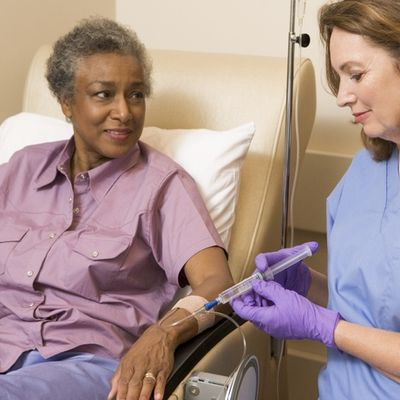 Black female patient with white female nurse getting an infusion