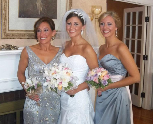 Cynthia and her daughters on the wedding day