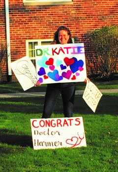 Dr. Katie Harmer celebrates earning her medical degree from the University of Rochester School of Medicine and Dentistry.