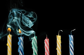 birthday candles with some lit and some blown out