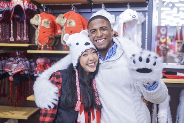 World of Coca-Cola -- Couple with Coca-Cola Polar Bear hats in Coca-Cola Store 1