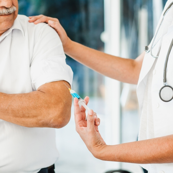 Latino senior vaccinated_GettyImages-1288952725