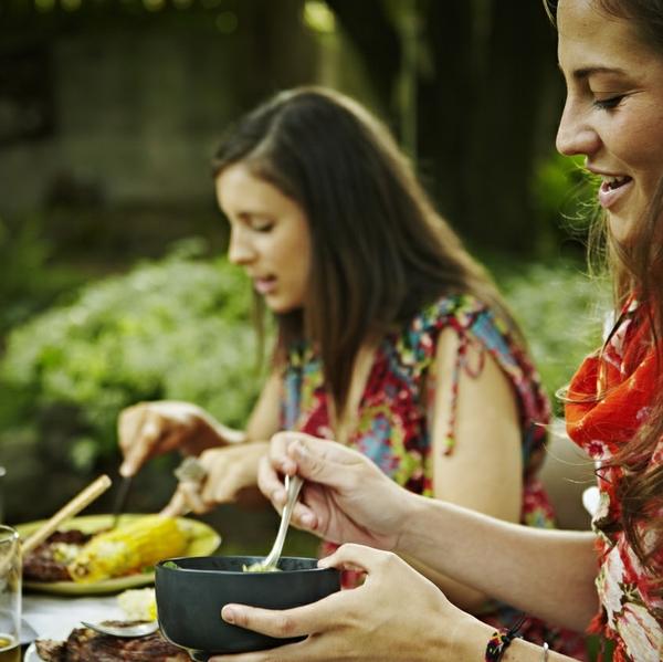 Latinos eating healthy food gathering family